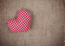 Handmade heart on sackcloth texture Royalty Free Stock Images