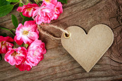 Handmade heart shaped tag with roses Stock Photos