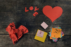 Handmade hearts and blank customizable post-its. On a vintage wodden table Stock Photos