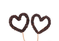 Handmade hearts from coffee beans. Royalty Free Stock Photography