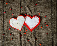 Handmade hearts decoration on warm knitted background. Valentines day concept. Vintage card with handmade hearts. Royalty Free Stock Images
