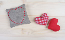 Handmade hearts on wooden background Stock Images