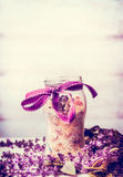Handmade herbal bathroom salts in jar with ribbon and fresh herbs royalty free stock photo