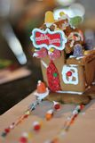Holiday Candy Shop Gingerbread House. Handmade Holiday Candy Shop Gingerbread House by kids royalty free stock image
