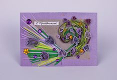 Handmade holiday card with flowers. Postcard decorated in quilling technique Royalty Free Stock Photo