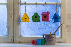 Handmade home for birds and colorful paint Royalty Free Stock Photo