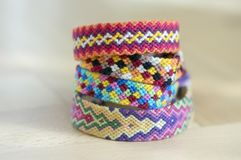 Free Handmade Homemade Colorful Natural Woven Bracelets Of Friendship Isolated On Light Blue Background, Pile Of Colorful Handcrafts Stock Images - 118799104