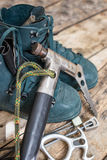 Handmade ice axe with old boots on wood background Royalty Free Stock Image