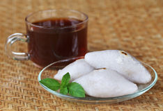 Handmade Indian cuisine of rice flour with cup of tea Stock Image