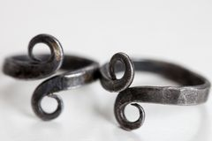 Handmade iron vintage rings with infinity symbol - selective focus/shallow depth of field. Handmade iron vintage rings with infinity symbol with selective focus/ royalty free stock photos