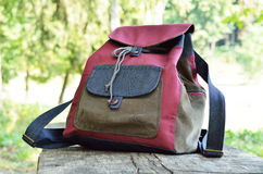 Handmade jean backpack outdoors Stock Photography