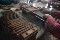 Handmade Jember's Cigars. The workers make handmade cigars at Jember, East Java, Indonesia. An export handmade cigars of Jember made from Jember's tobacco and royalty free stock photography