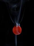 Handmade jewellery and smoke Stock Photography
