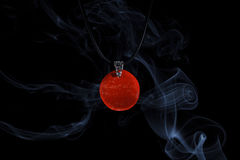 Handmade jewellery and smoke Royalty Free Stock Images