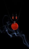 Handmade jewellery and smoke Royalty Free Stock Image