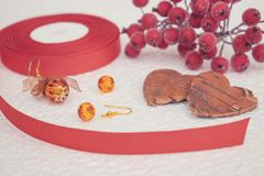 Handmade Jewelry, DIY close up in red and brown. Jewelry designer workplace. Materials for creation handmade earrings with amber. And wire. fashion femininity royalty free stock photo