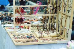 Handmade jewelry is sold on the street. royalty free stock images