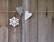 Handmade Jewelry on a wooden background. Christmas. Heart and sn Royalty Free Stock Photo