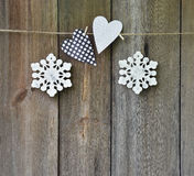 Handmade Jewelry on a wooden background. Christmas. Heart and sn Royalty Free Stock Photography