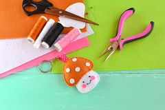 Handmade keychain. Felt toy mushroom, thread, needle, scissors, pins, pliers. Kids crafts Stock Photography