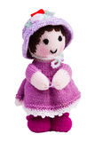 Handmade knit toy, pink doll. In her hat and dress Royalty Free Stock Photography