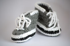 Handmade knitted baby bootees Stock Images
