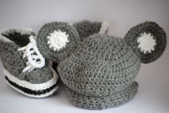Handmade knitted baby clothes Stock Image