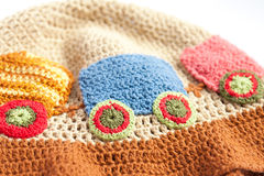 Handmade knitted backpack and colorful tangles of yarn Stock Image