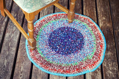 Handmade knitted colorful rug Stock Photos
