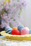 Handmade knitted Easter eggs and lilac flower Royalty Free Stock Photo