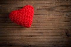 Handmade knitted heart Stock Photo