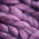 Handmade knitted large blanket, super chunky yarn, trendy concept. Purple color