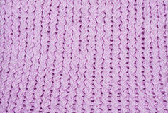 Handmade knitted pink wool background Stock Photography