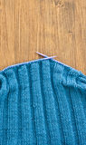 Handmade knitted scarf with blue wool Royalty Free Stock Images