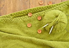 Handmade knitted scarf with green wool Royalty Free Stock Photos