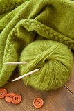 Handmade knitted scarf with green wool Stock Photos