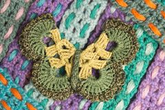 Handmade wool knitted butterfly colorful texture background Stock Images