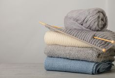 Handmade, knitting and woolen thread. Pile of knitted clothes bl Royalty Free Stock Photography