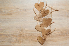 Handmade Kraft Paper hearts on wooden background texture Royalty Free Stock Photo