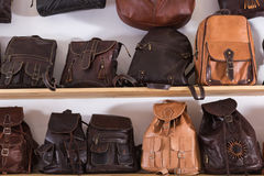 Handmade leather backpacks and bags on shelf  in shop Stock Photography