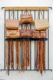 Handmade leather bags and belts for sale. Handmade leather bags and belts in front of a white wall for sale on a street royalty free stock photos
