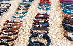 Handmade leather bracelets sold at local city market. Provence. France stock photography