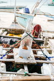 Handmade light source for night fishing on the native boat with fishing nets in the background Stock Photo