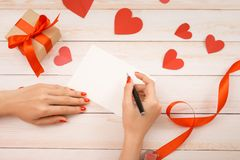 Handmade love card for valentine day on wooden background. Handmade love card for valentine day on wooden background stock photo