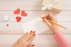 Handmade love card for valentine day on wooden background.  royalty free stock photos