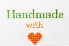 Handmade with love phrase embroidered cross stitch Royalty Free Stock Photo
