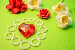 Handmade love themes flowers and red glass heart with highlights. Congratulations Royalty Free Stock Images