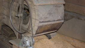 Handmade machine sifting grain in barn. Closeup stock footage