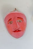 Handmade mask hanging on the wall Royalty Free Stock Images