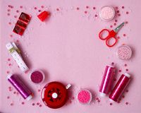 Handmade materials on a pink background. stock photo